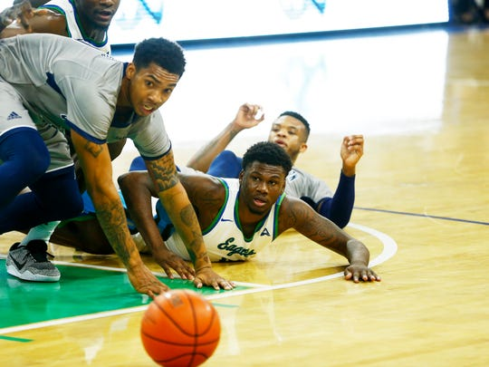 FGCU and Georgia Southern players watch as the ball rolls out of bounce at Alico Arena on Tuesday, Dec. 13, 2016. FGCU lost the game with a final score of 59-72.