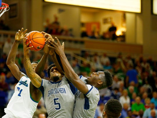 FGCU senior Demetris Morant, left, jumps for a rebound against Georgia Southern at Alico Arena on Tuesday, Dec. 13, 2016. FGCU lost the game with a final score of 59-72.