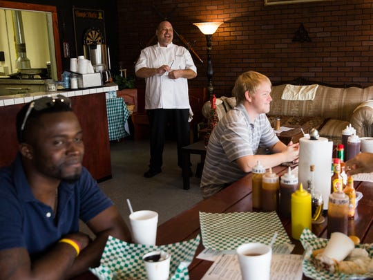 Owner Arthur Meade, center, laughs with customers at Meade's BBQ in the San Carlos Park neighborhood of south Lee County on Thursday, Dec. 22, 2016. Meade and his wife, Rhonda, opened their restaurant on Halloween this year.