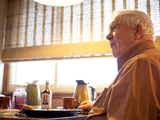 Frank Woehrle, builder of The Patio Restaurant in 1964, enjoys a plate of steak and eggs at the restaurant.