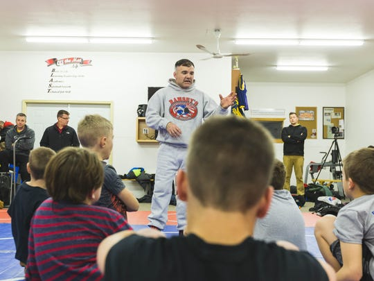 Joe Ramsey works with young wrestlers looking to improve their game at Ramsey's International School of Wrestling.