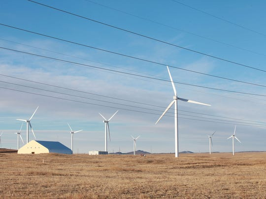 Duke Energy's Happy Jack wind farm near Cheyenne, Wyoming generates electricity on Dec. 6, 2016.