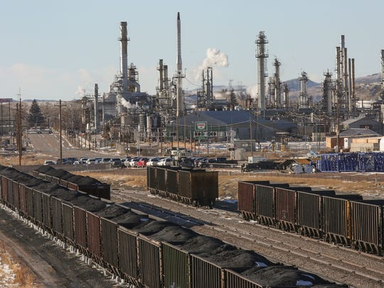 Trainloads of coal sit idle outside the Sinclair Oil