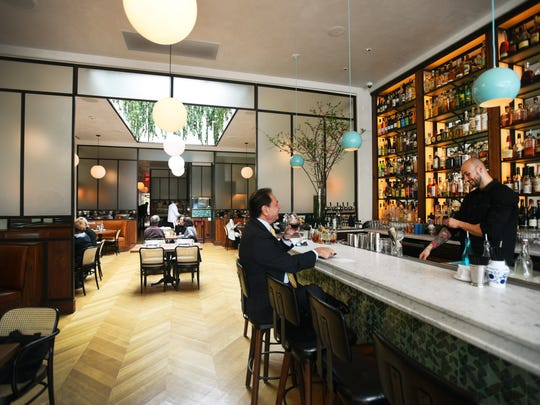 Toast your true love at the marble bar in the main dining room at Sofia in Englewood.