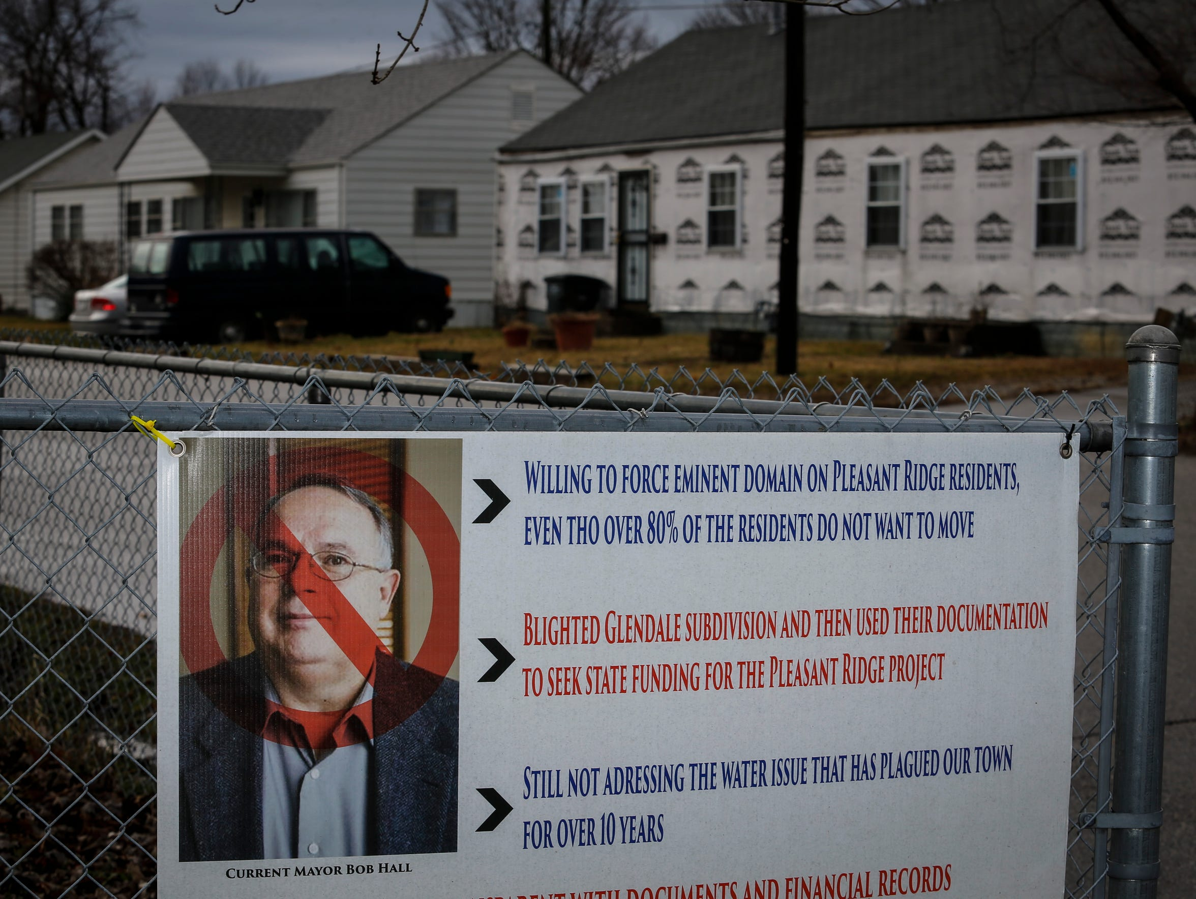 A sign with a portrait of Charlestown mayor Bob Hall