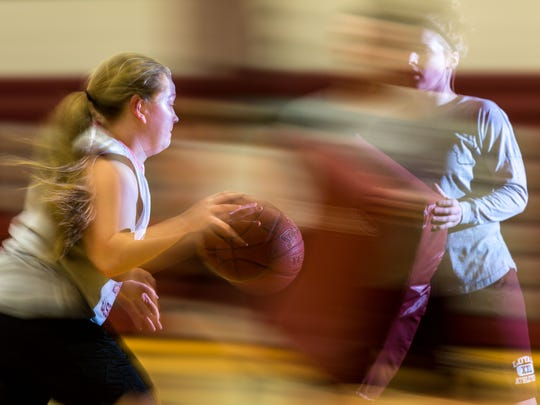 Greyhound sophomore, Amanda Krasselt, dibbles past a defender as the Loyal Greyhounds practice at Loyal High School on March 7, 2017 before heading to the Resch Center in Green Bay, Wis., on Thursday March 9, 2017 to play Bangor in a Division state semifinal game.