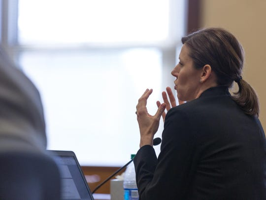 Prosecuting attorney Tania Bonnett speaks to Judge Daniel Wood during the sentencing for Kenneth Conrad, who was convicted of sexually assaulting an 11-year-old adopted daughter.
