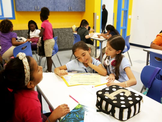 Students work on school work at the Boys & Girls Club