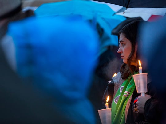 Members of Wausau and the surrounding communities gather at Kennedy Park on March 26, 2017, in Weston Wis., for a candlelight vigil to mourn with those affected by the shootings on March 22, 2017 in Rothschild, Wis.