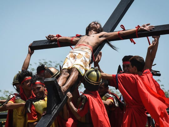 Philippines - A man is depicted as nailed to the cross in San Pedro Cutud village on April 14, 2017 in San Fernando, Philippines. The annual crucifixion rites draws huge crowds of people to normally sleepy towns in northern Philippines.