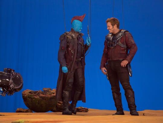 Michael Rooker and Chris Pratt go over a scene on the