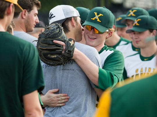 St. Xavier's Cameron Scheler greets alumni Wednesday evening at St. Xavier before their game against Pleasure Ridge Park High School. May 10, 2017