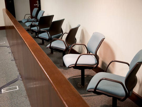 Empty chairs await those alleged of committing a felony as they appear during a brief felony arraignment hearing in Hearing Room 3-4 at the Collier County Courthouse Monday, May 15, 2017 in Naples.