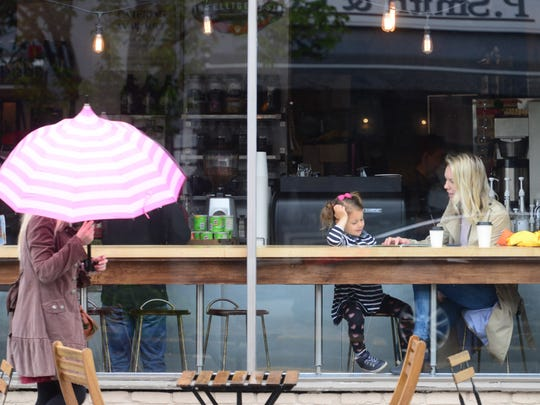 The Ridgewood Coffee Company offers a prime seat for people-watching.