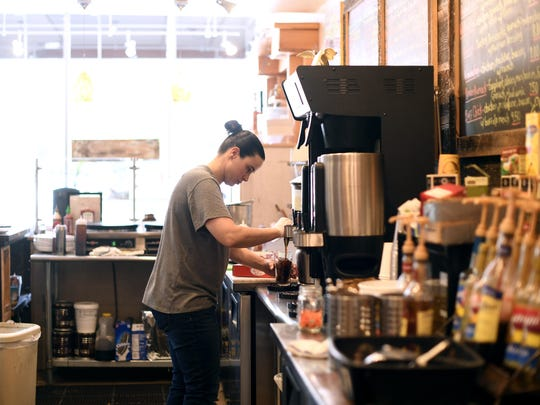 Alissa Vitale makes an iced coffee at Sogno Coffee