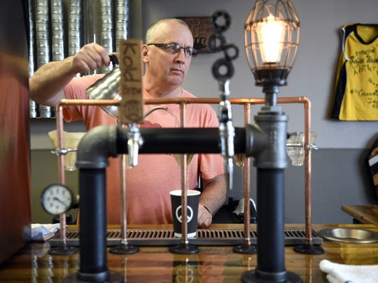 Bruce Pettineo, the owner of Koffeewagon Roasters, pours a cup in his store on Route 17 in Hasbrouck Heights.