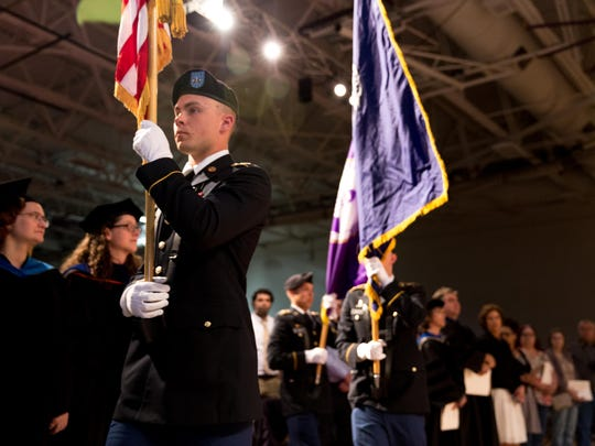 The UWSP ROTC Color Guard makes their way towards the front of the Quandt Fieldhouse with the American Flag on May 20, 2017 in Stevens Point, Wis.