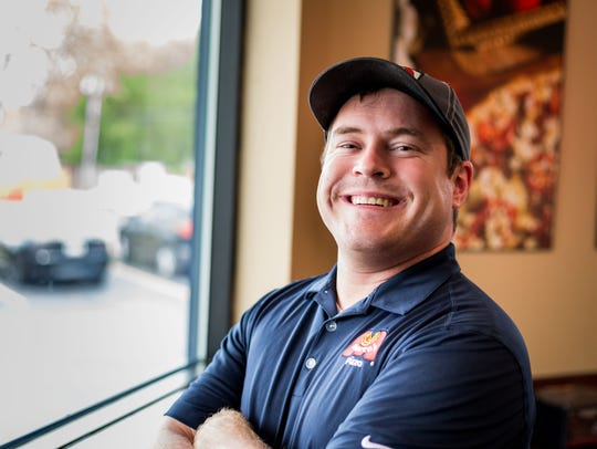 Jordan Brovick, district manager of Marco's Pizza,
