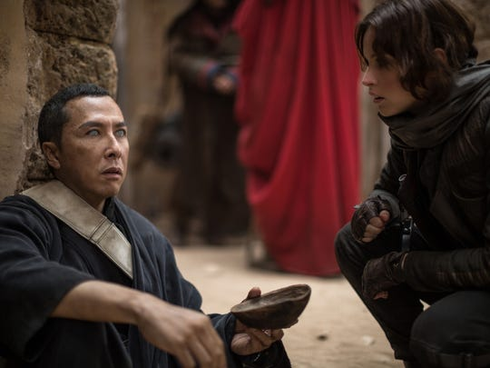 """Chirrut Îmwe (Donnie Yen) meets Jyn Erso (Felicity Jones) for the first time in """"Rogue One."""""""