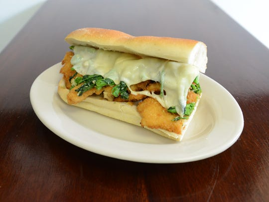 20008836A.  HAWTHORNE, N.J.  10/8/2015.  HOAGIES INFORMAL DINING:  Bogie's Hoagies, a shop owned by Paul Beaugard, in Hawthorne features: Hoagie with chicken cutlet, brocoli rabe, provolone.