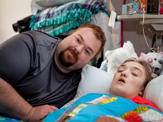 Jason, father of Tirza Sutton, smiles along side Tirza