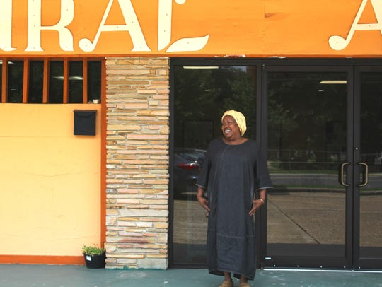 Jameelah El-Amin stands outside the Pamoja Cultural