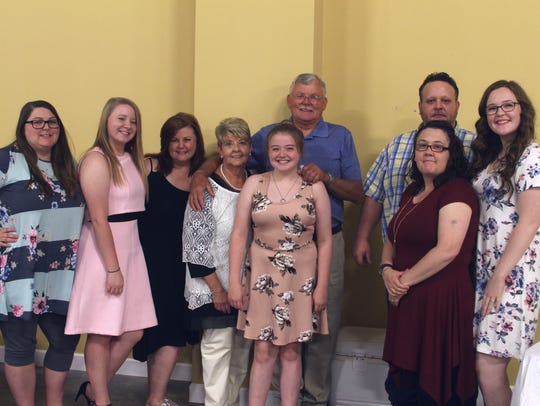 The family of Sharon Tomlinson attended her retirement