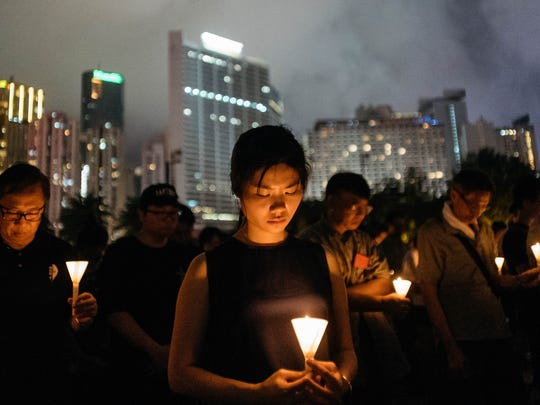 Participants take part at the candlelight vigil at
