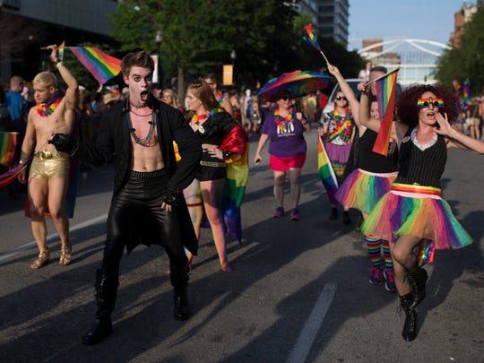 Participants cheer to the crowds during the Kentuckiana Pride Festival Parade on Main Street. June 16, 2017