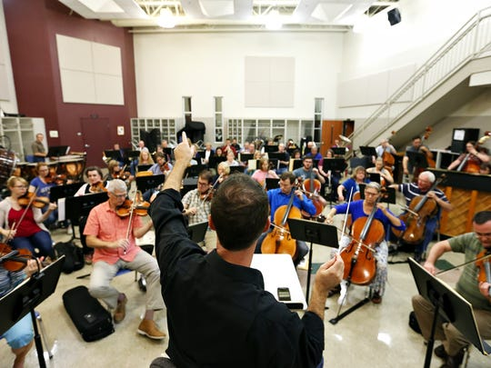 "Springfield Symphony Orchestra music director and conductor Kyle Wiley Pickett signals instructions during a rehearsal of Prokofiev's ""Romeo and Juliet"" at Evangel University in Springfield, Mo. on Sept. 13, 2016."