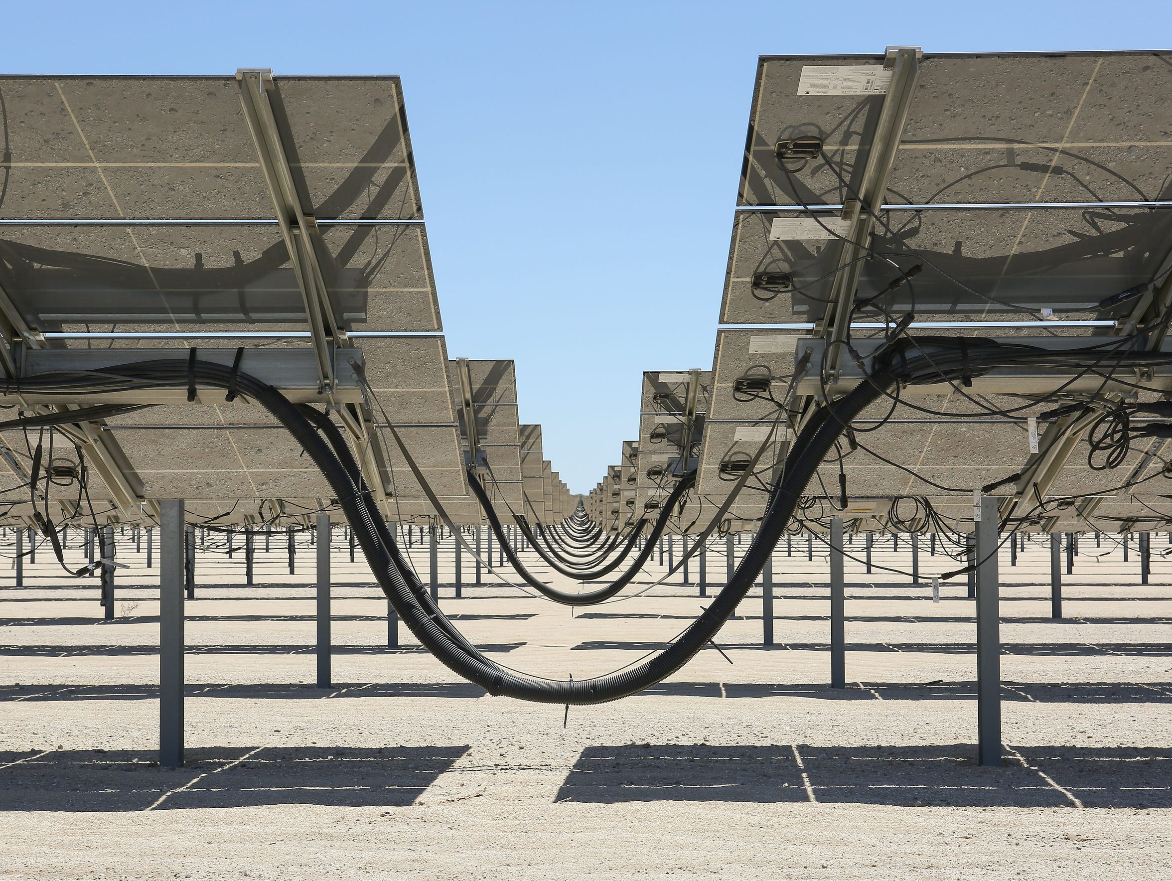 Solar panels generate electricity at the 50-megawatt