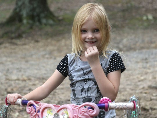 Sasha Buchanan, 6, plays outside her home in Robertson