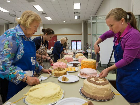 """Judges Elizabeth Coots, right, Janette Chapman, left and Luci Hockersmith, center cut slices of of entrants in the """"cake from a mix"""" competition at the Kentucky State Fair. Aug. 15, 2017."""