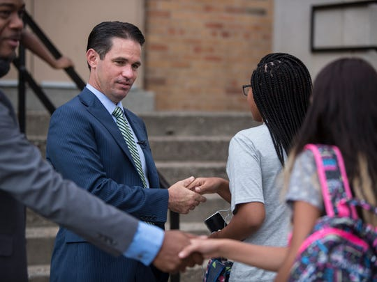 Dr. Marty Pollio, center, Acting Supertintendent of Jefferson County Schools greeted students as they arrived at Central High School, for the first day of classes. On the left is Central HIgh principal Raymond Green. Aug. 17, 2017.