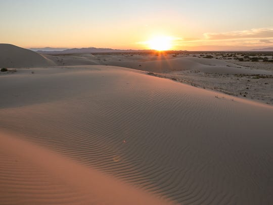 The sun sets over the Cadiz Dunes in Mojave Trails National Monument. Environmentalists say the Cadiz project, which would involve pumping groundwater on land surrounded by the monument, would harm natural springs and wildlife.