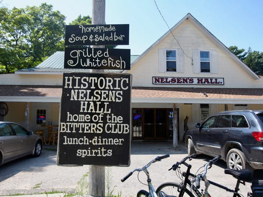 Nelsen's Hall has been a landmark on Washington Island since 1899 and today attracts tourists to take a shot of bitters and join its famous Bitters Club.