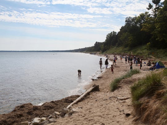 A 1.5-mile sandy beach lines the shore of Lake Michigan