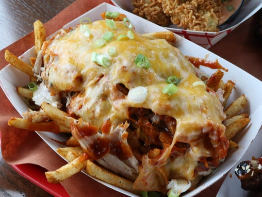 These fries at kimchi smoke are fully loaded with cheese,