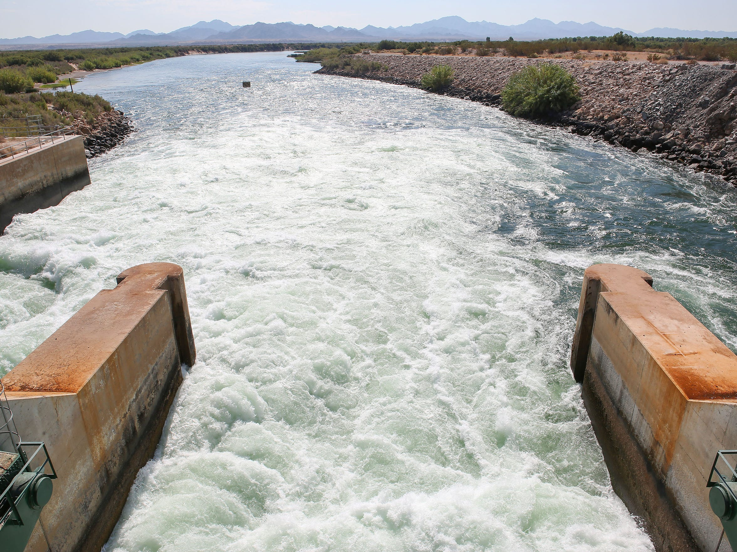 The Colorado River flows out of the Palo Verde Diversion Dam near Blythe.