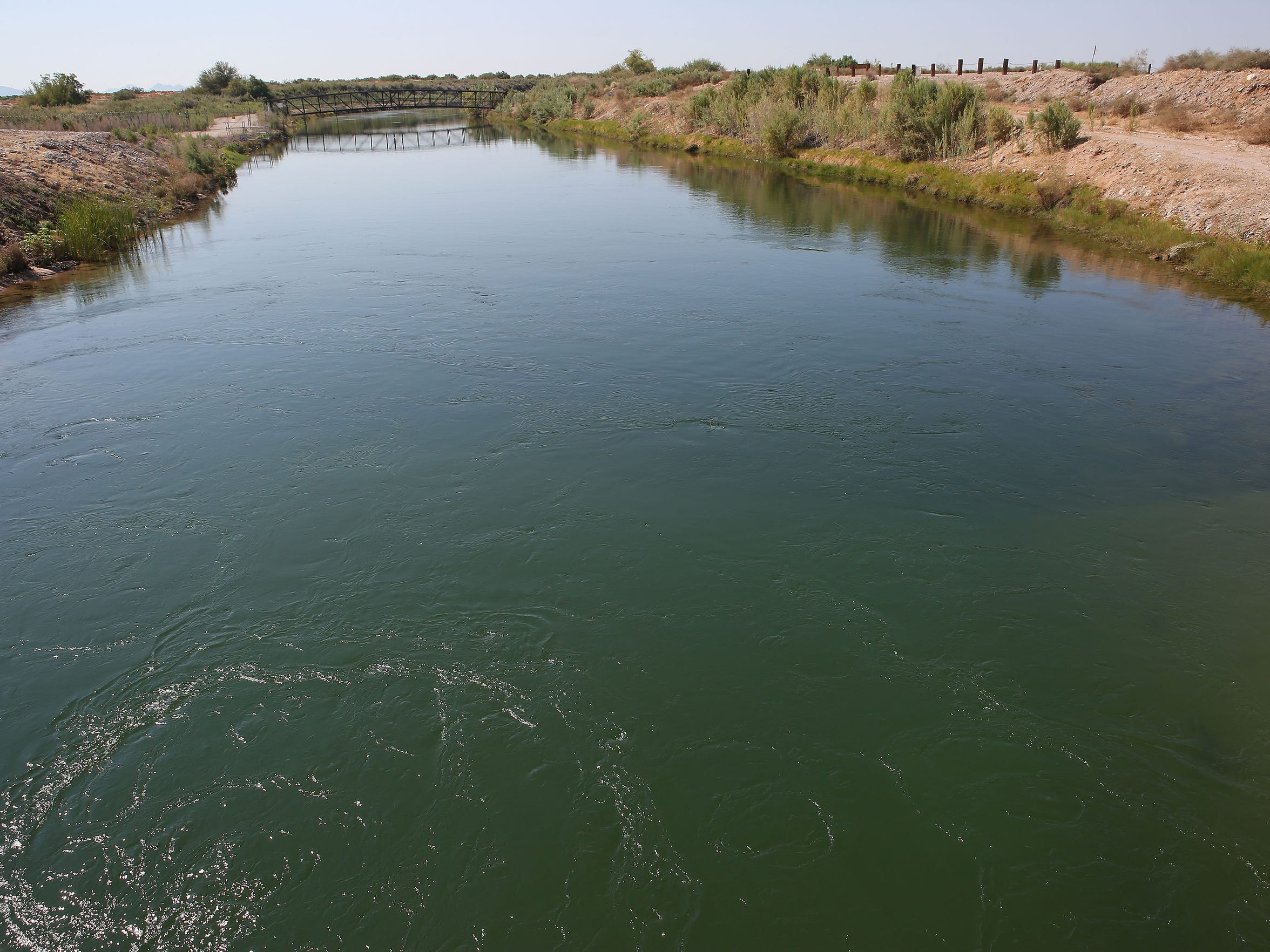 Water diverted from the Colorado River flows out of the Palo Verde Diversion Dam, entering the valley's canal system.