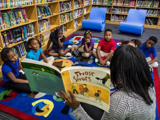 Literacy Teacher Development Specialist Irene Holden reads to second graders at Buena Vista Elementary School in this file photo.