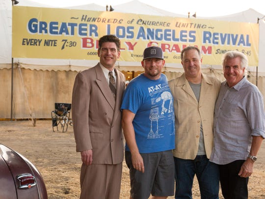 """Will Graham (from left), director Harold Cronk, producer Matt Baer and Louis Zamperini's son Luke in front of the tent that filmmakers re-created for """"Unbroken: Path to Redemption."""""""