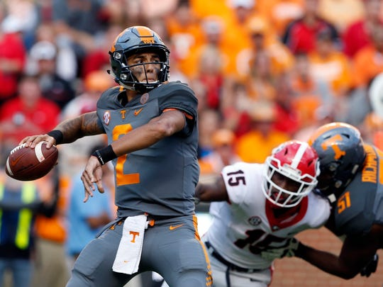 FILE - In this Sept. 30, 2017, file photo, Tennessee quarterback Jarrett Guarantano (2) throws to a receiver in the second half of an NCAA college football game against Georgia, in Knoxville, Tenn. Tennessee is making a quarterback switch with Jarrett Guarantano taking over for Quinten Dormady as the Volunteers seek to bounce back from their first shutout loss since 1994. Vols coach Butch Jones said Wednesday, Oct. 11, 2017, that Guarantano would get the starting nod Saturday when Tennessee (3-2, 0-2 SEC) hosts South Carolina (4-2, 2-2). (AP Photo/Wade Payne, File)