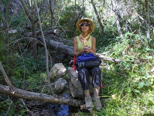 Amanda Frye sits in the west fork of Strawberry Creek