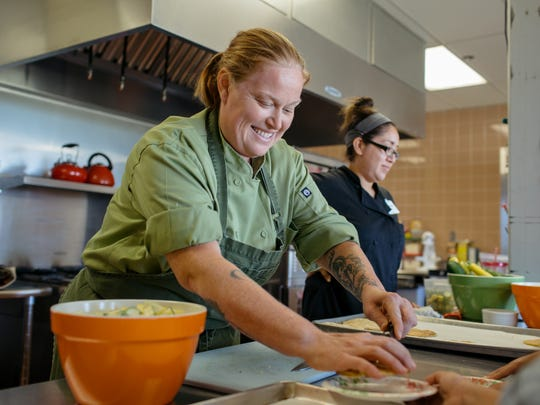 As part of the Blue Watermelon project, chef Charleen Badman (FnB) shows Encanto Elementary School students how to make squash blossom quesadillas and calabacitas.