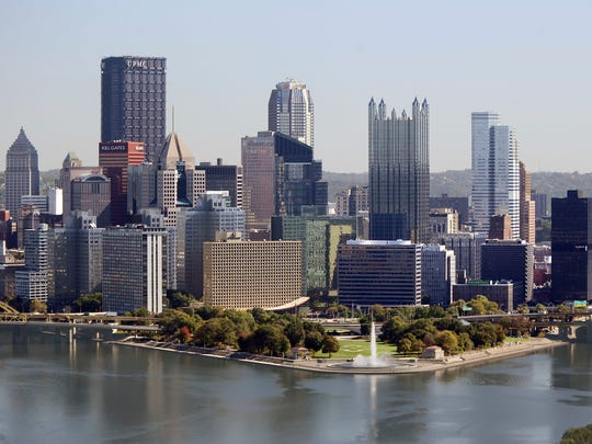 The Pittsburgh skyline is seen from the West End Overlook, a city park, Wednesday, Oct. 18, 2017. Pittsburgh is one of dozens of cities working frantically to land Amazon's second headquarters. Amazon is promising $5 billion of investment and 50,000 jobs over the next decade and a half. Yet the winning city would have to provide Amazon with generous tax breaks and other incentives.