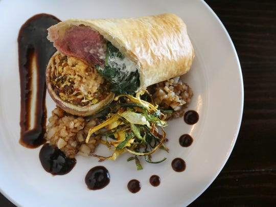The lamb en croute with roasted zucchini stuffed turnip and pear mint relish at Gary's on Spring. Oct. 26, 2017