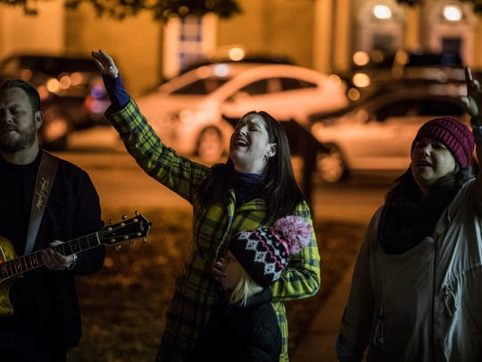 Jamé Swilley and daughter Joscelin, 9, participate in a prayer vigil at Murfreesboro town square on Wednesday night.  Seeds Church gathered for the vigil before the upcoming white nationalist rally, Oct. 25, 2017.