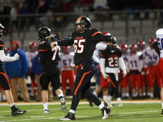 Solon's Tyler Linderbaum celebrates after forcing a
