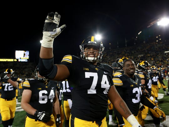 Iowa's Tristan Wirfs waves to fans following the Hawkeyes'